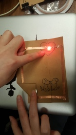 When the paper is folded the circuit is closed and the LED lights up